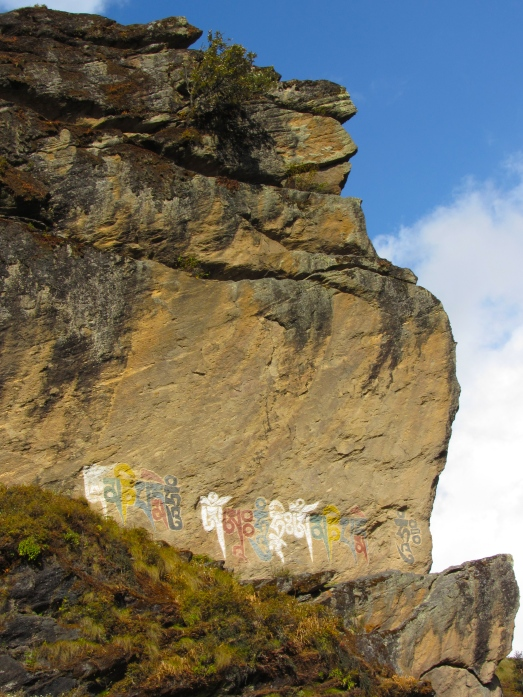Om mani padme om- ancient writing on the cliff face