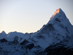 Fist fingers of the sun alighting on Amadablam.