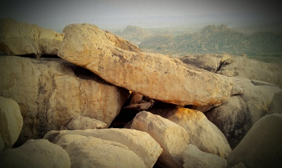 The entier land scape is composed of boulders. As if Hanuman exploded out of the very rocks.