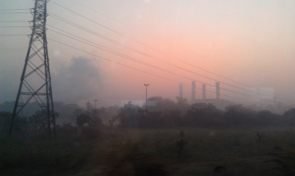 Sunrise in Delhi, overnight a human made fog settles over the city from trash fires.
